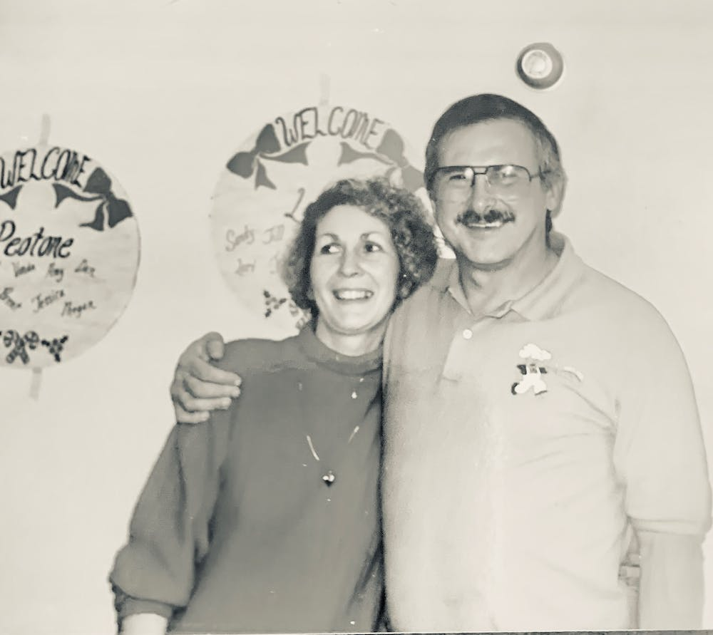 a man and woman posing for a photo
