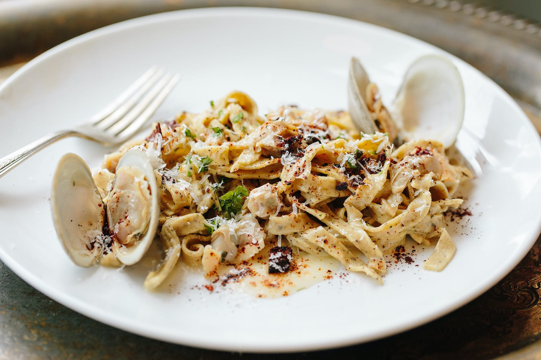 a plate of pasta with oysters