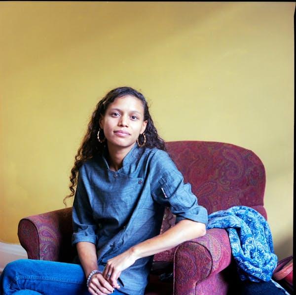 a woman sitting on a sofa