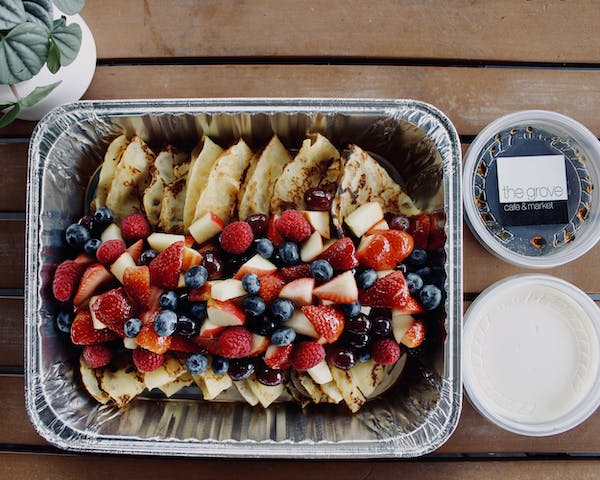 pancakes with fruits on a tray