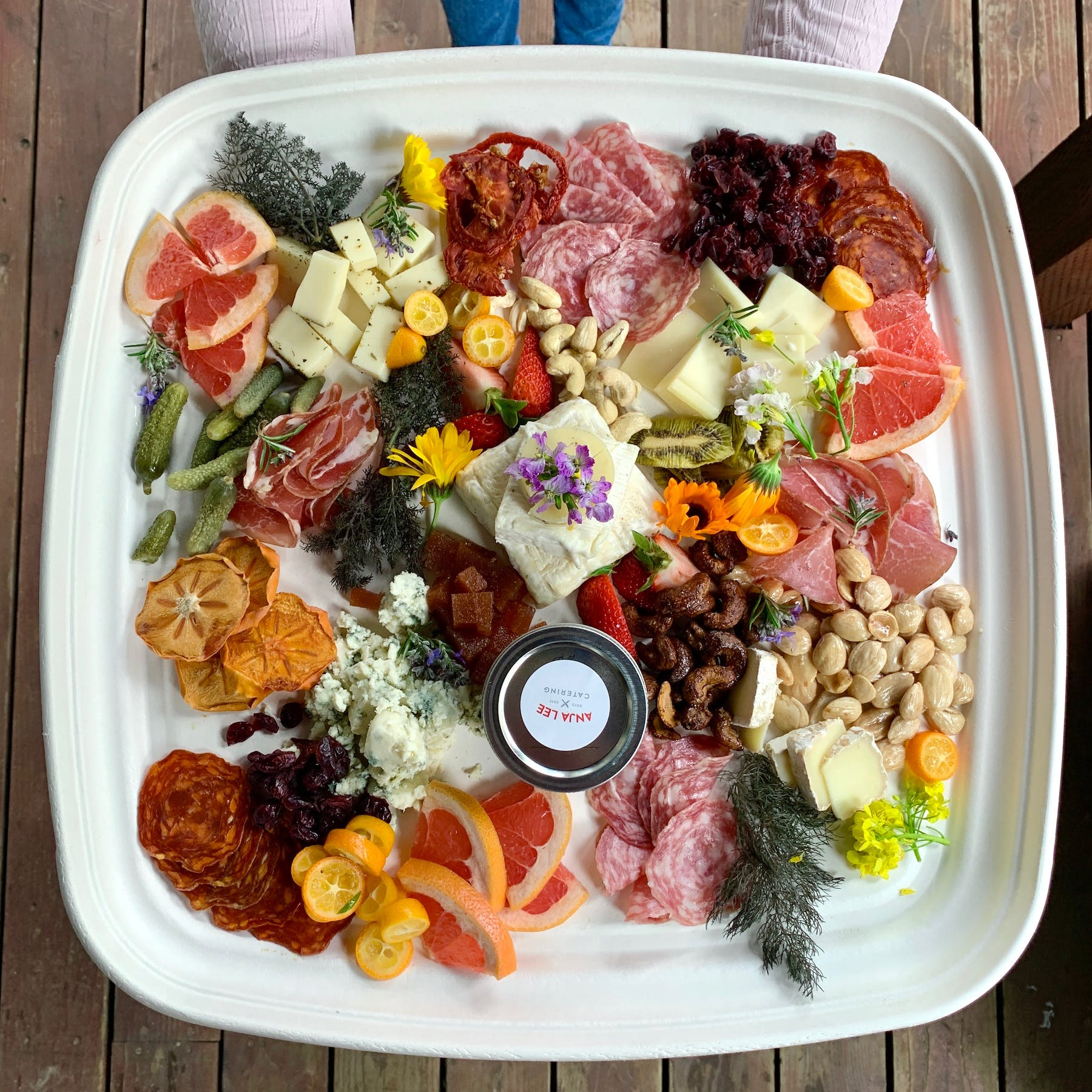 a plastic container filled with different types of food on a plate