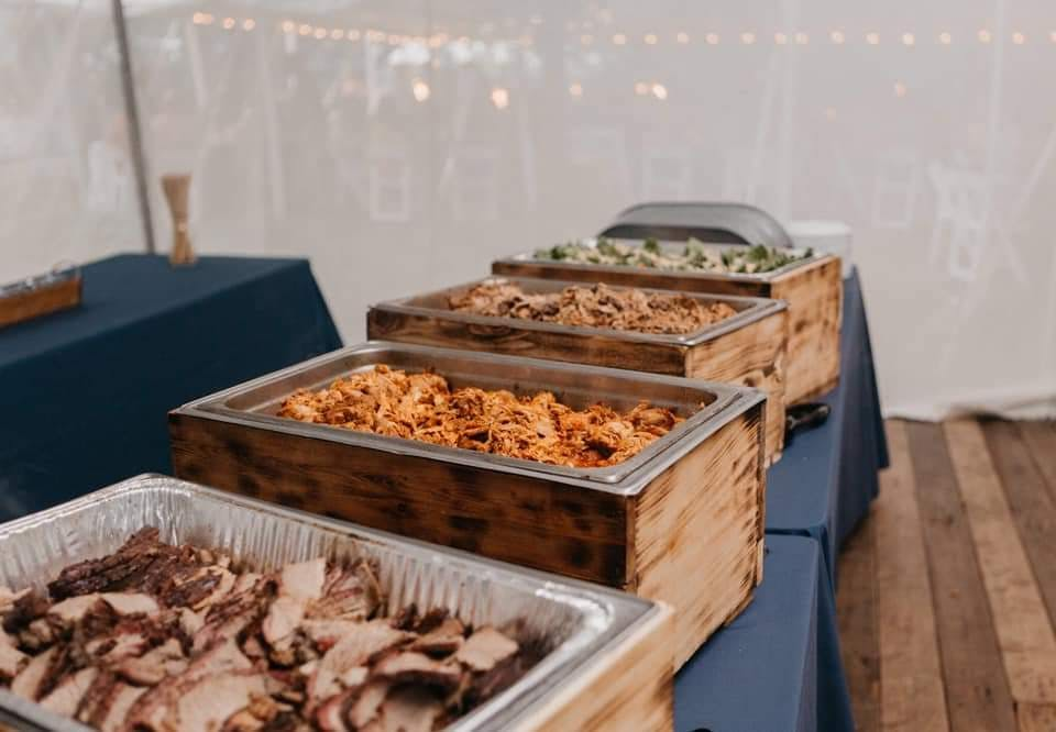 several trays of food on a table