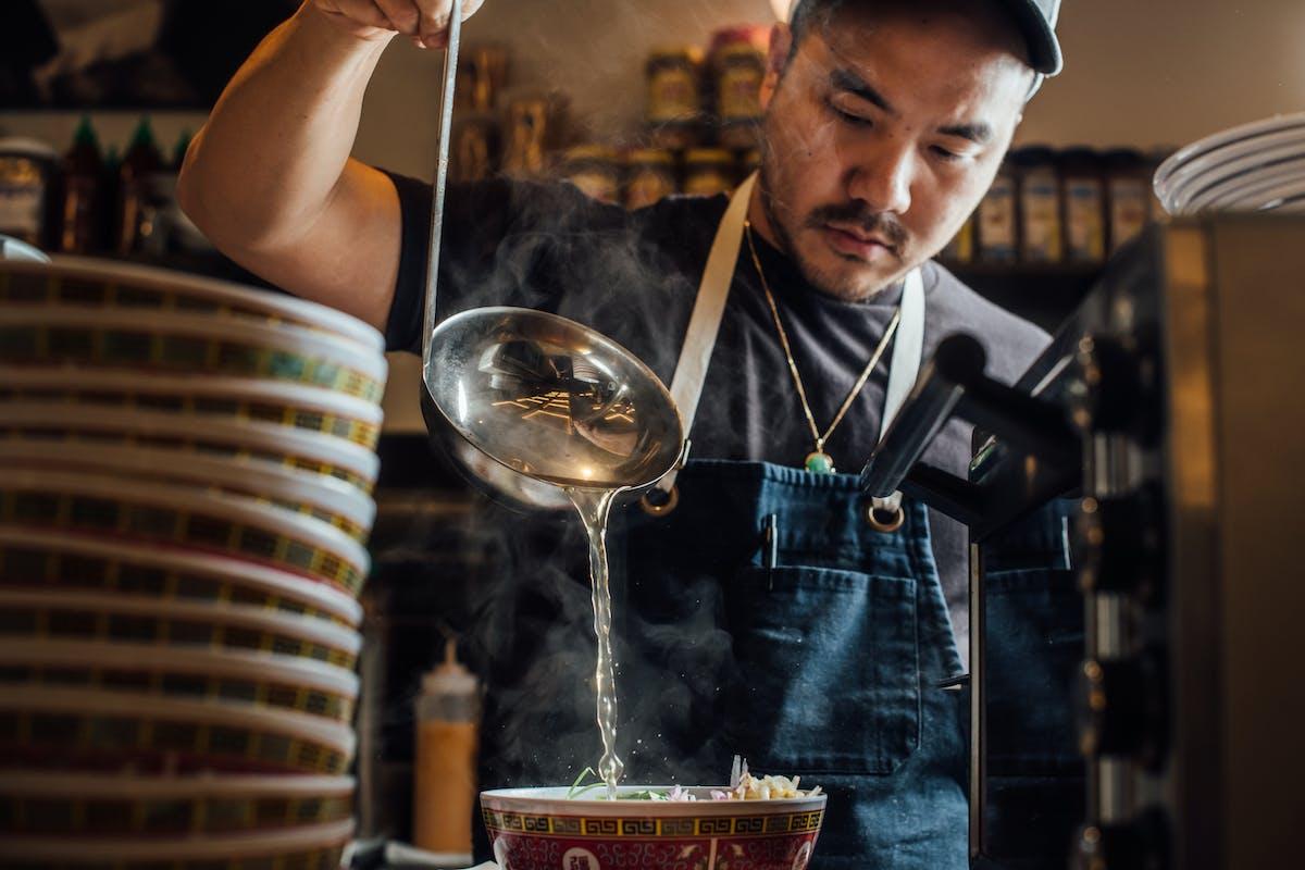 Man pouring soup