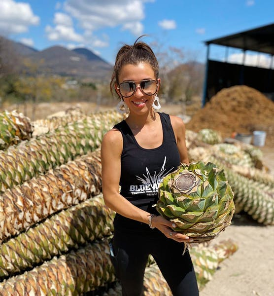 a woman holding an agave plant