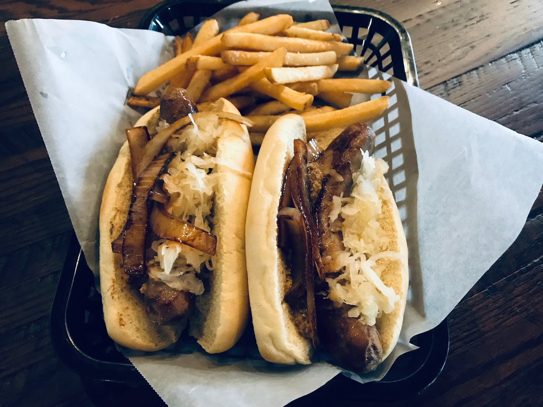 a basket of fries and a hot dog on a bun