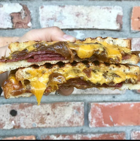 a large sandwich sitting on top of a building
