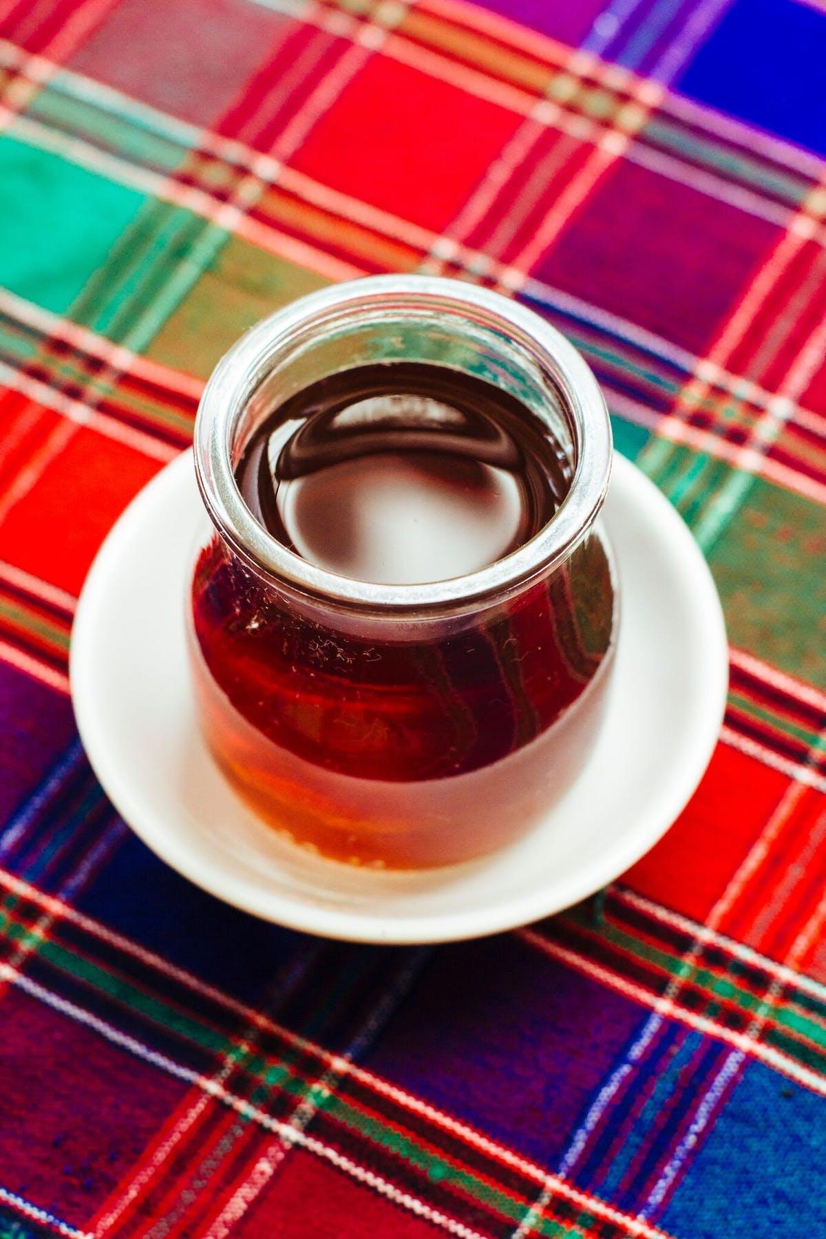a close up of a plate with a fork and a cup of coffee