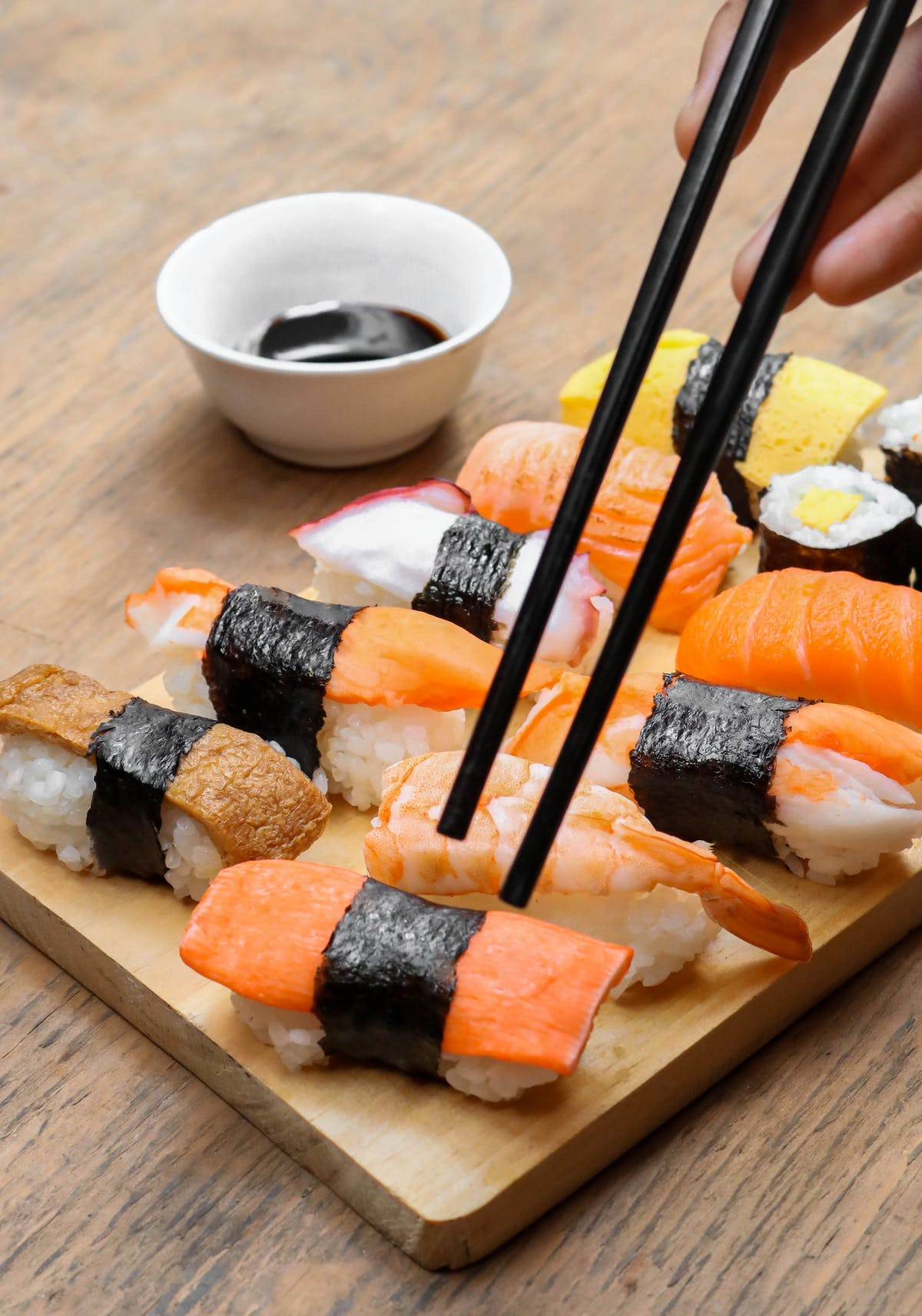 sushi on a wooden cutting board