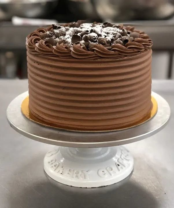 a close up of a chocolate cake sitting on top of a table