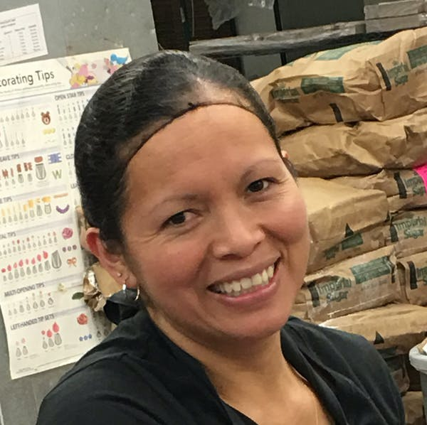 a woman smiling for the camera