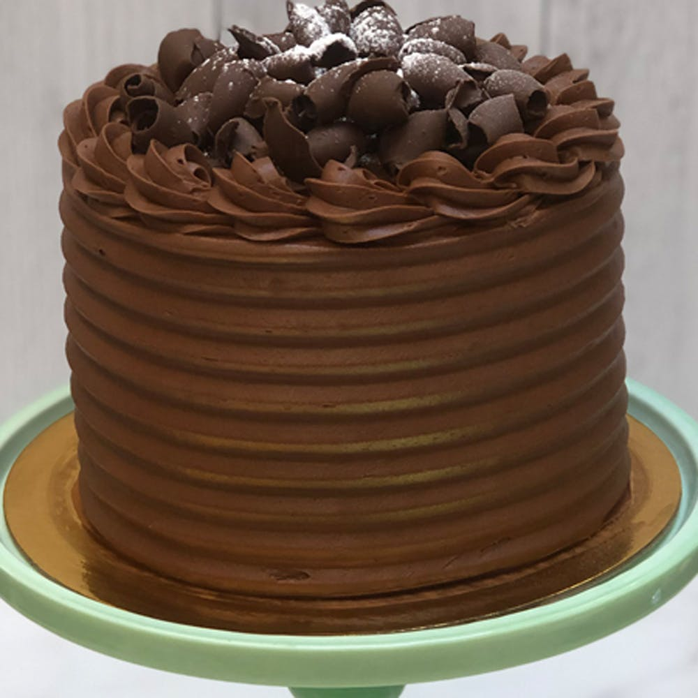 a large chocolate cake on a plate