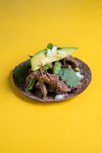 a blue tortilla taco on a table