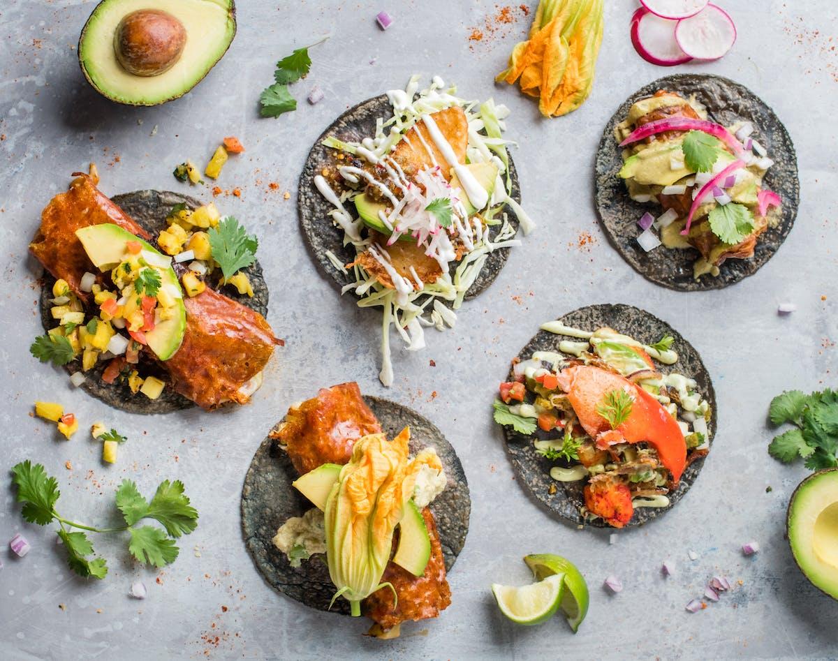 blue tortilla tacos on a table