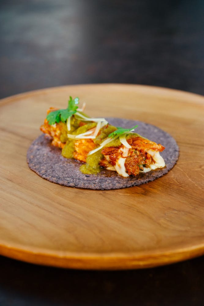 a close up of a taco on a wooden table