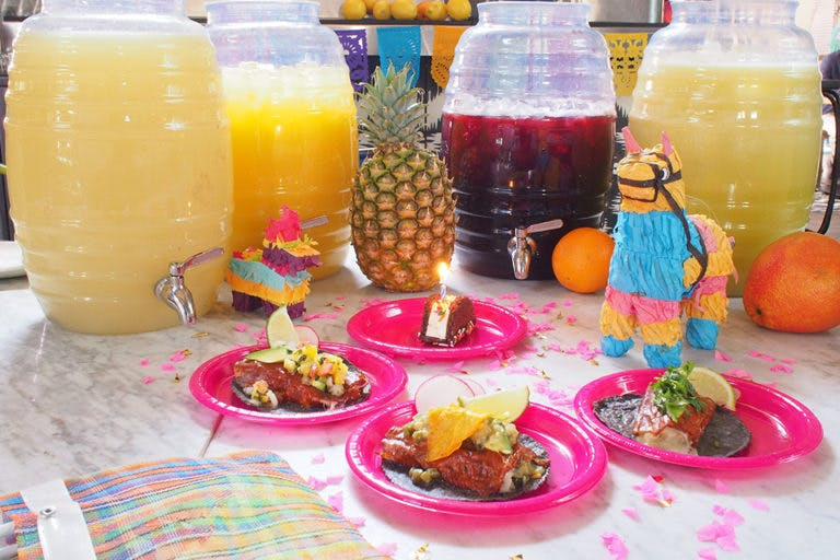 a table topped with plates of food and drinks