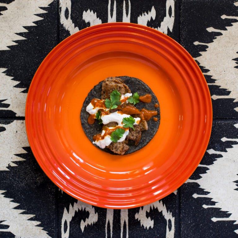 a blue tortilla taco on a plate