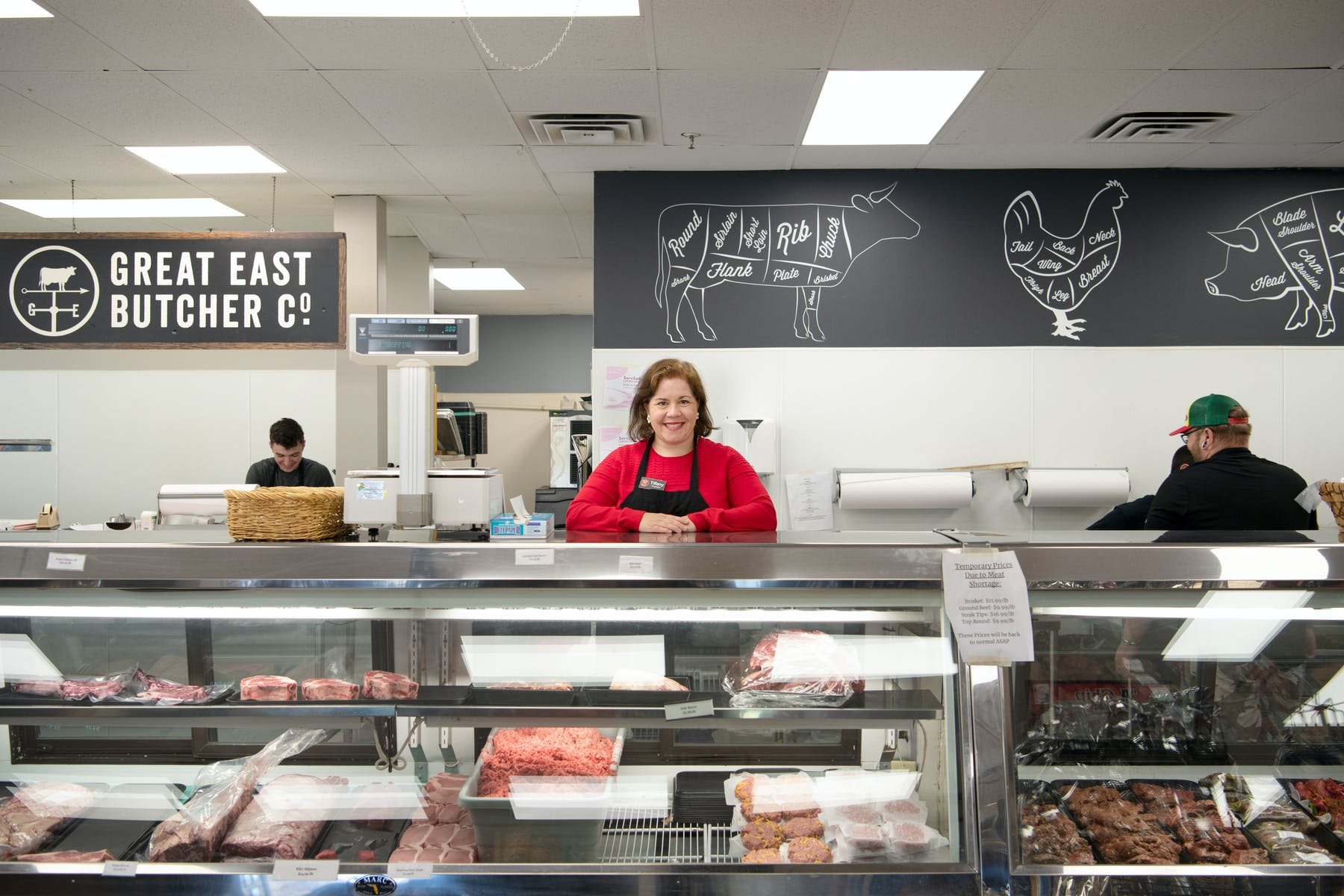 A professional standing behind the deli of burger provider The Great East Butcher in Portland, ME