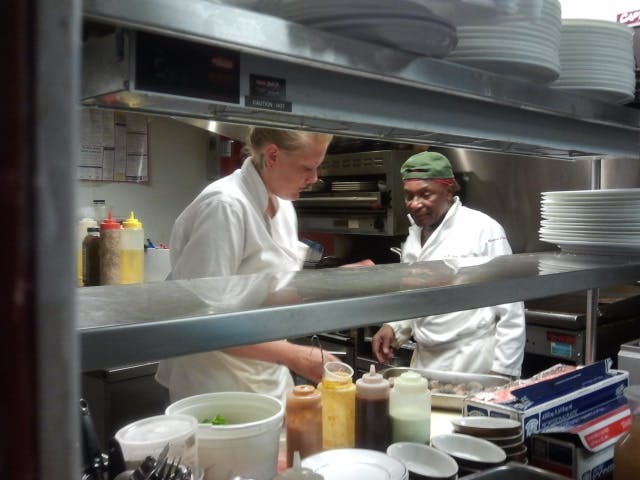a person cooking in a kitchen preparing food