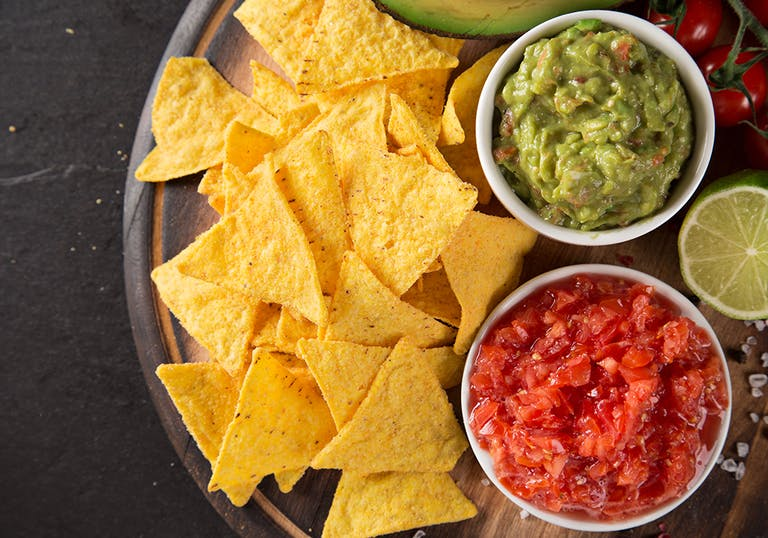 platter with tortilla chips, guacamole and salsa