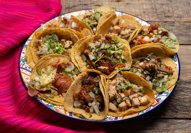 a platter of various tacos