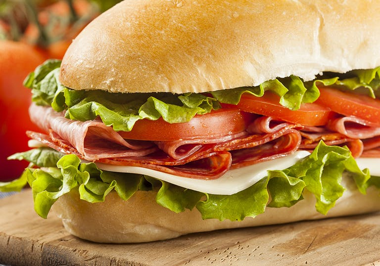 a close up of a sandwich with salami
