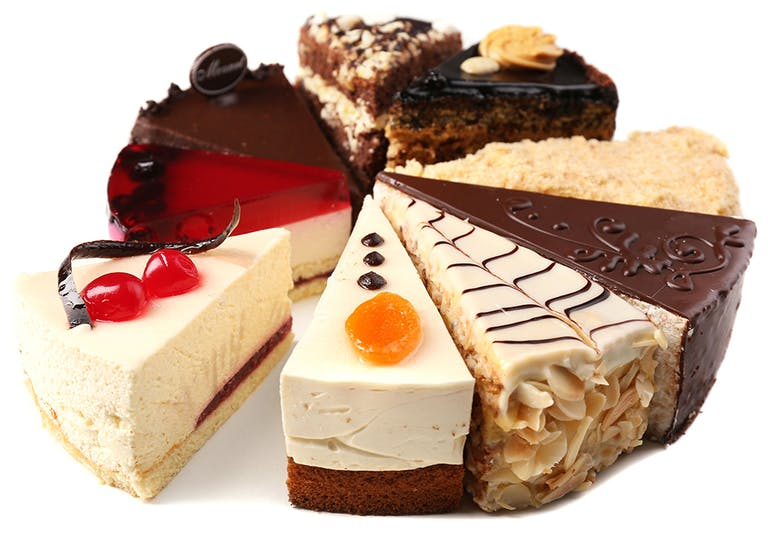 different styles of cheesecake slices on display