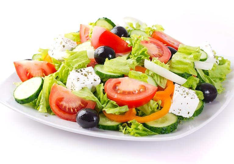 a small plate of greek salad