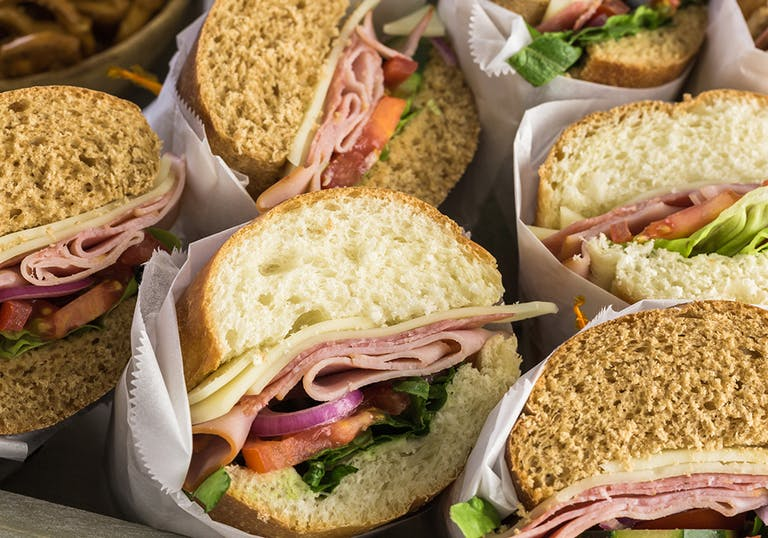 a variety of cold cuts sandwiches