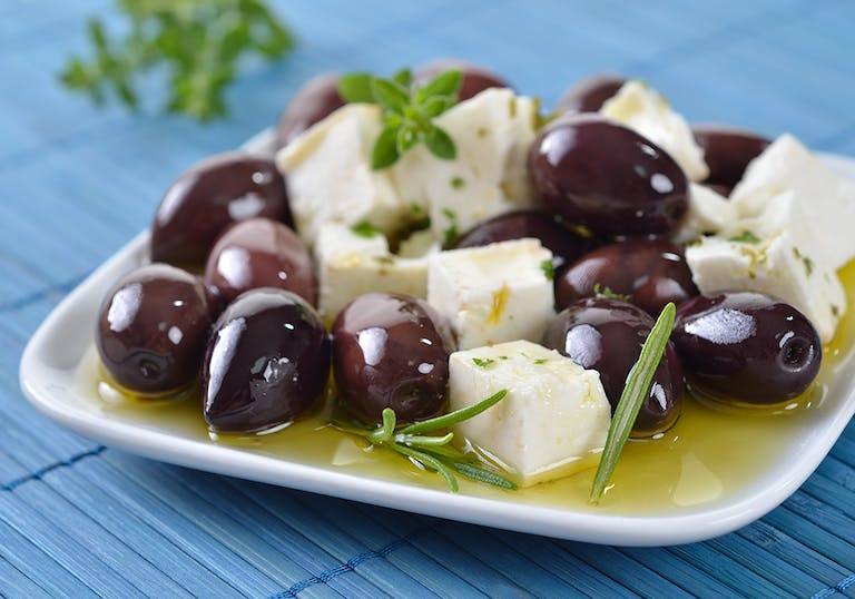 a plate of olive and feta salad