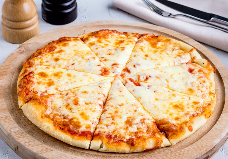 a cheese pizza on wooden board