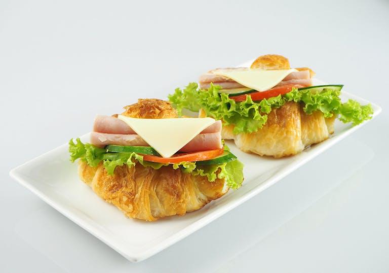 mini croissant sandwiches on a plate