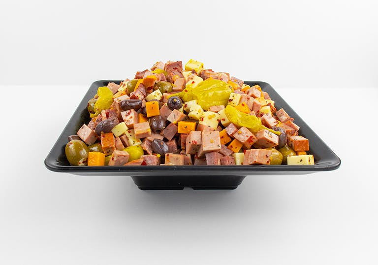 a tray of cubed meats, cheeses, and olives