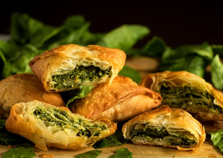greek spinach pie bites on a wooden table