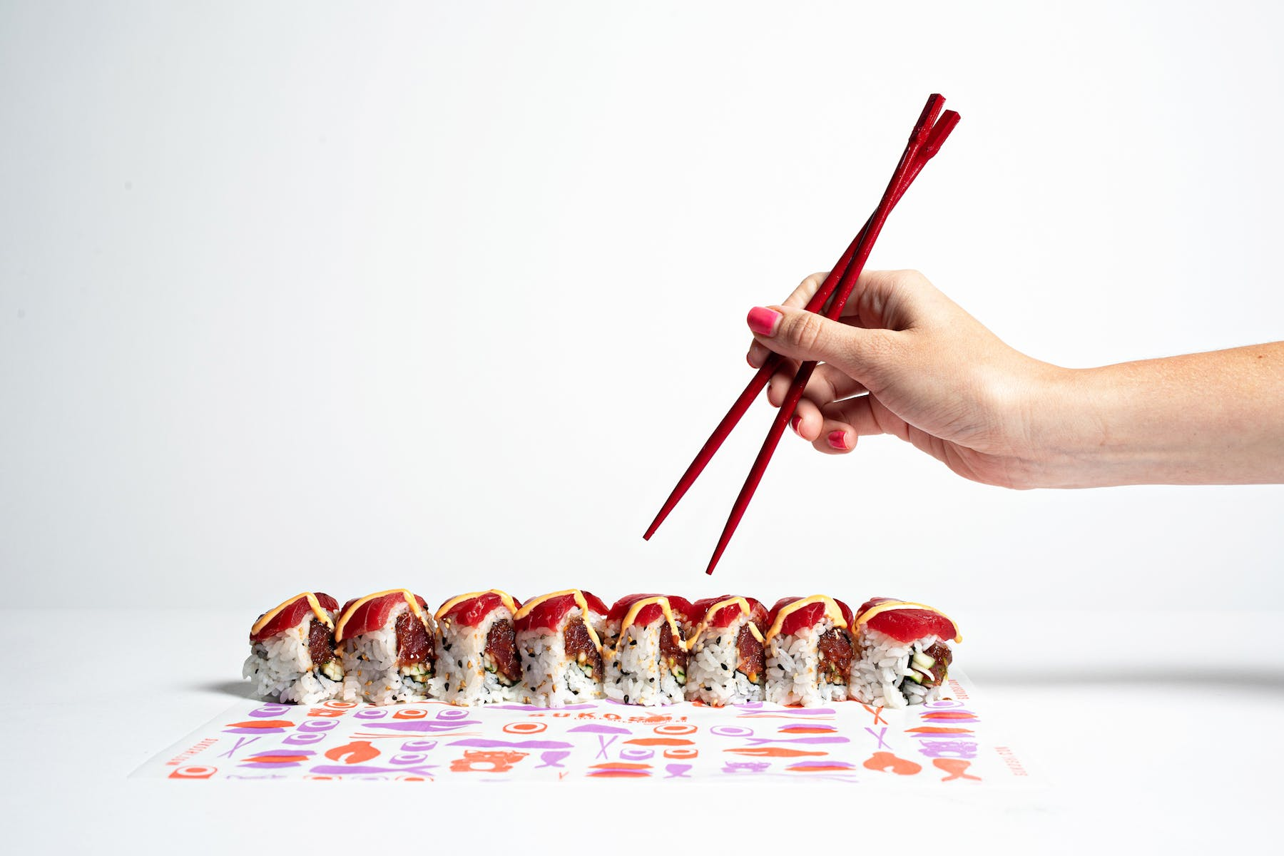 Sushi roll with chopsticks ready to indulge