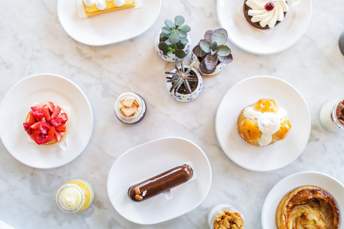 an array of platters topped with different desserts