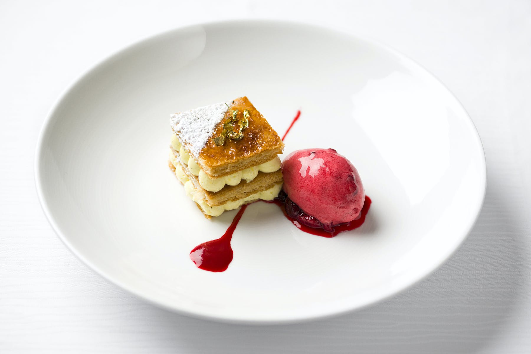 a white plate topped with a small dessert