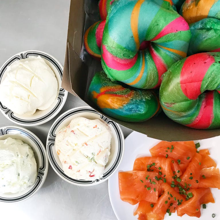 rainbow bagels with cream cheese and lox