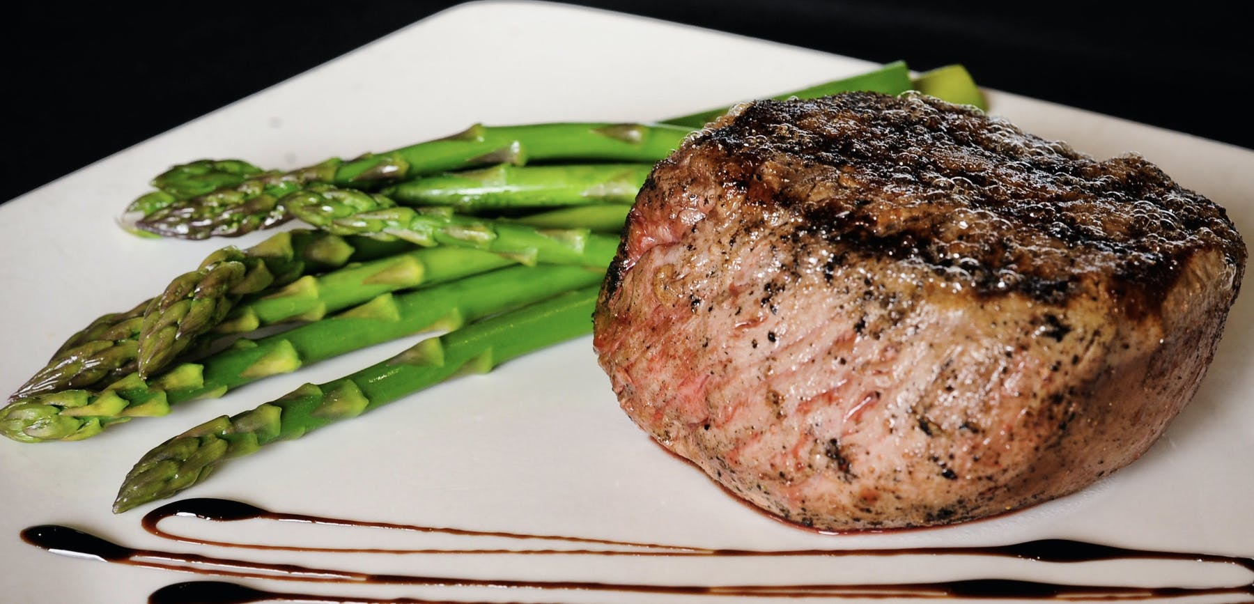 steak served with asparagus