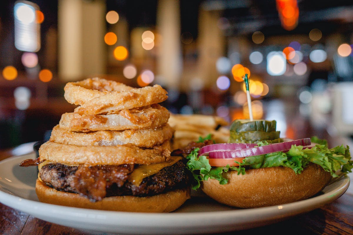 a burger with onion rings