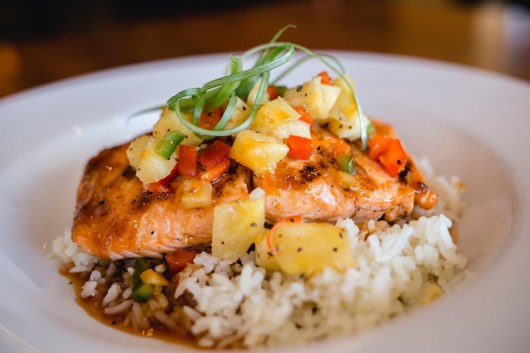 salmon served over a pile of rice