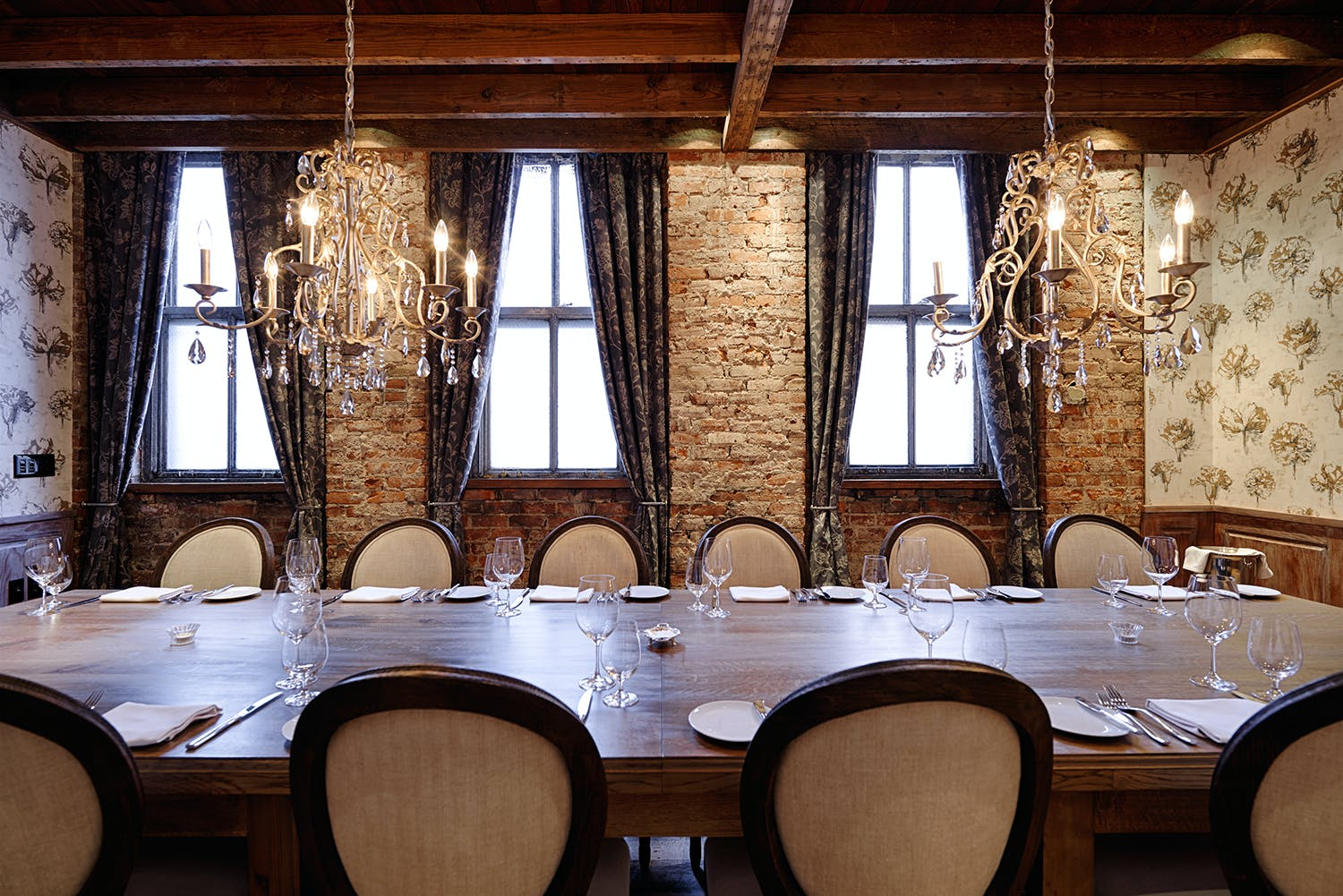 a large dining table topped with utensils