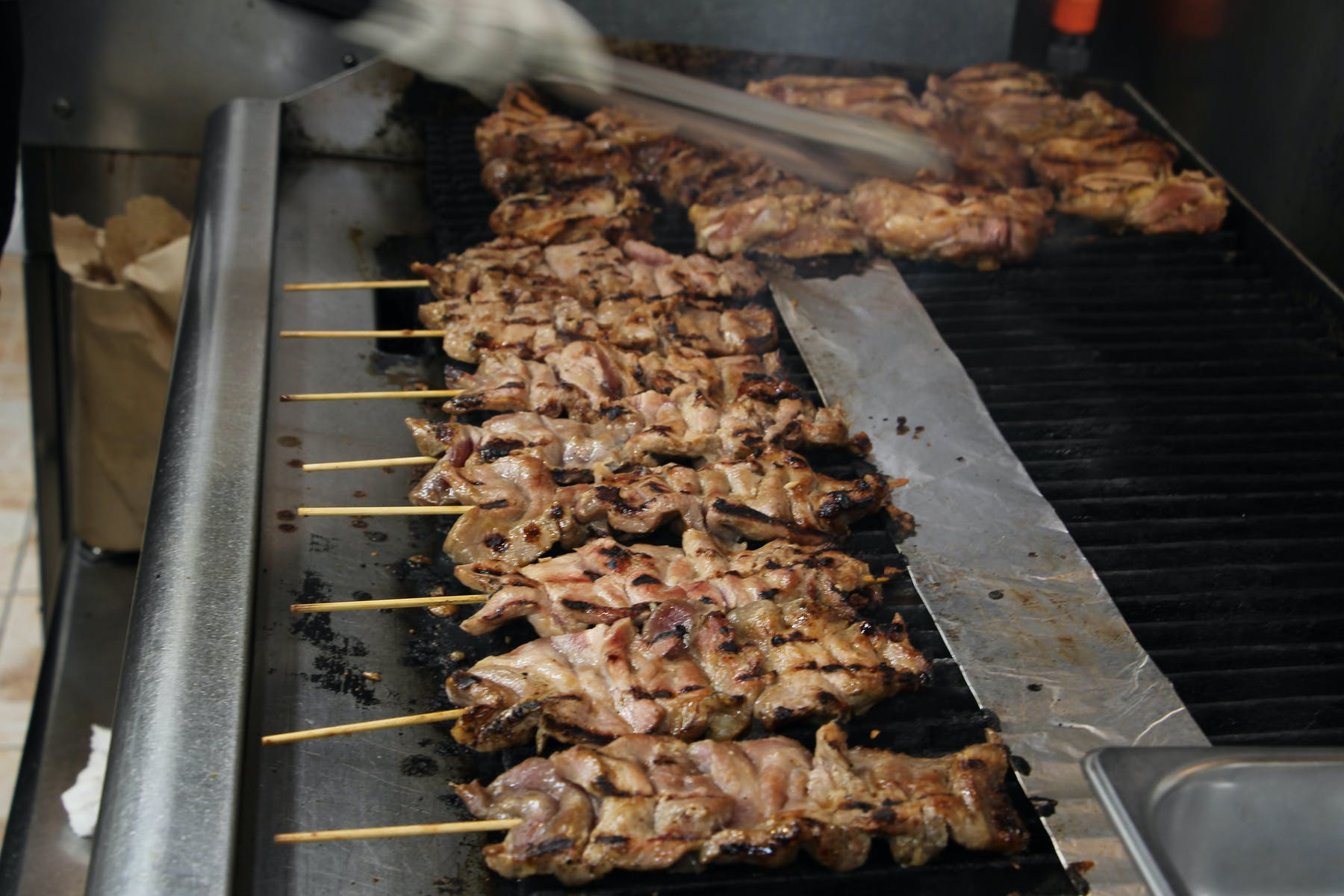 bbq meat skewers cooking on a grill