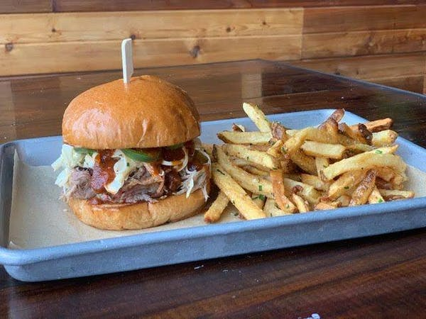 a chicken sandwich and fries on a table