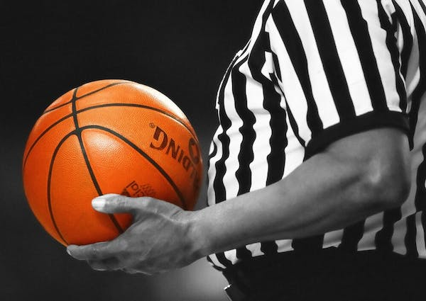a close up of a person holding a basketball