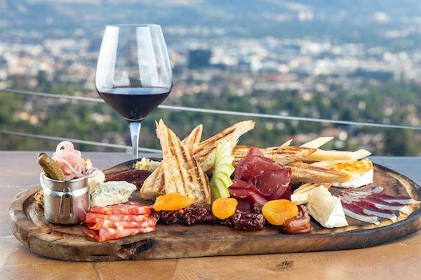 Charcuterie with wine and view