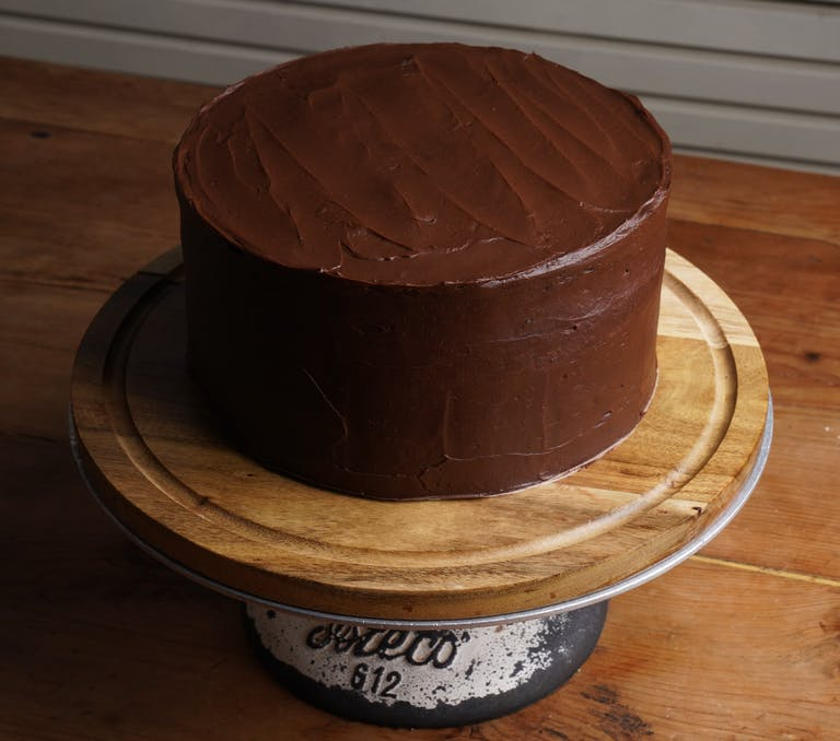 a chocolate cake sitting on top of a wooden table