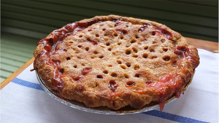 a pizza sitting on top of a table