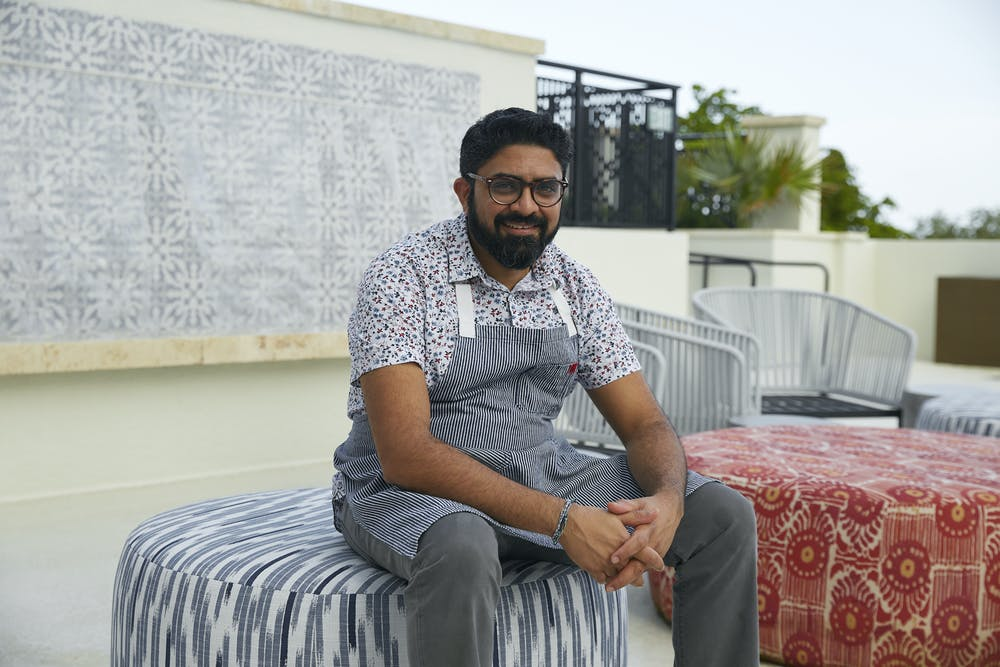 a man sitting on a bed