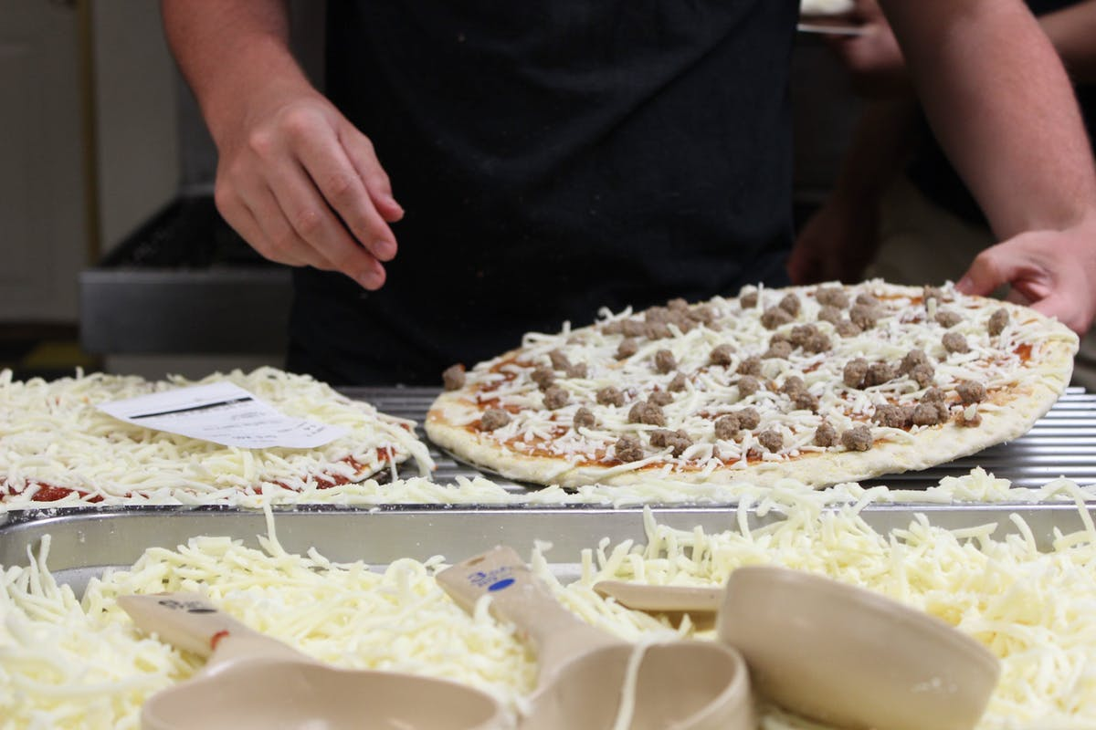 a person making a pizza