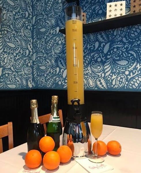 a dining table with champagne